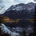 View over the mountain lake Eibsee in Germany with snowy mountains in the background